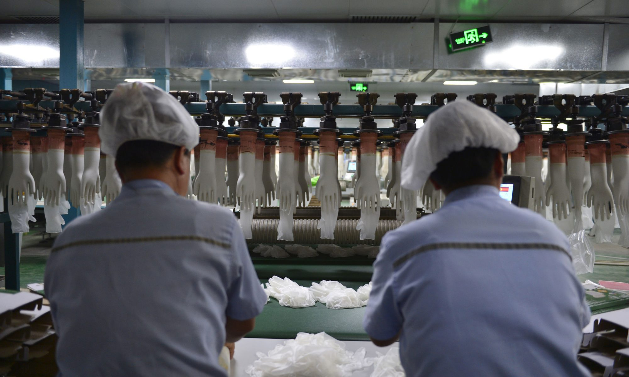 Workers on the disposable glove production line. Photo by Song Qiuju/123rf